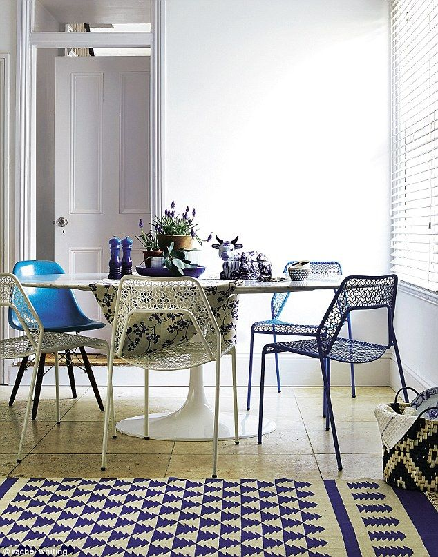 TABLE, £2,600, Go Modern. METAL CHAIRS in white and blue, £135 each, Heal's. OCEAN BLUE SIDE CHAIR, £375, SCP. On table: COW CERAMIC CONTAINER, £59, and BLUE PLATTER, £76, both SCP. SALT & PEPPER SET, £35, Le Creuset. SMALL PATTERNED BOWLS, £6 each, Royal Doulton. NAVY KEW Fabric, £39.50 per m, Ian Mankin. KNIVES & FORKS, £3.50 each, Utility. BLUE STRIPE GLASS, £16, Abode. PLANTS and PLANT POTS, stylist's own. MODESSA RUG, from £60, John Lewis. BASKET, £19.35, Abode. PLATE (in basket, just…
