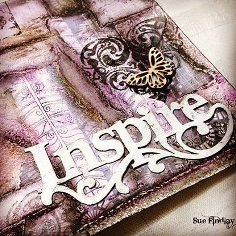Work in Progress - My Inspiration Art Journal. The background was created using ripped colouring book pages and colourised with oil crayons. I also used stamps and wood chip embellishments to add interest.