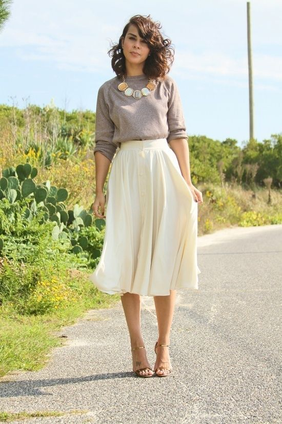 Love the simple but dressed-up look of the plain grey and white and an amazing statement necklace.