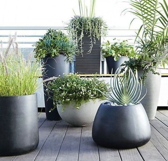 Good shapes, sizes, & modern colors. 37 Modern Planters To Make Your Outdoors Stylish | DigsDigs