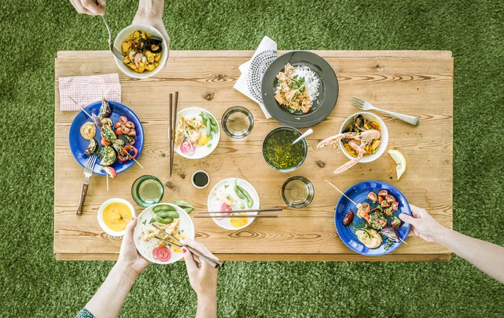 An aerial view of a table with tapas-style dishes