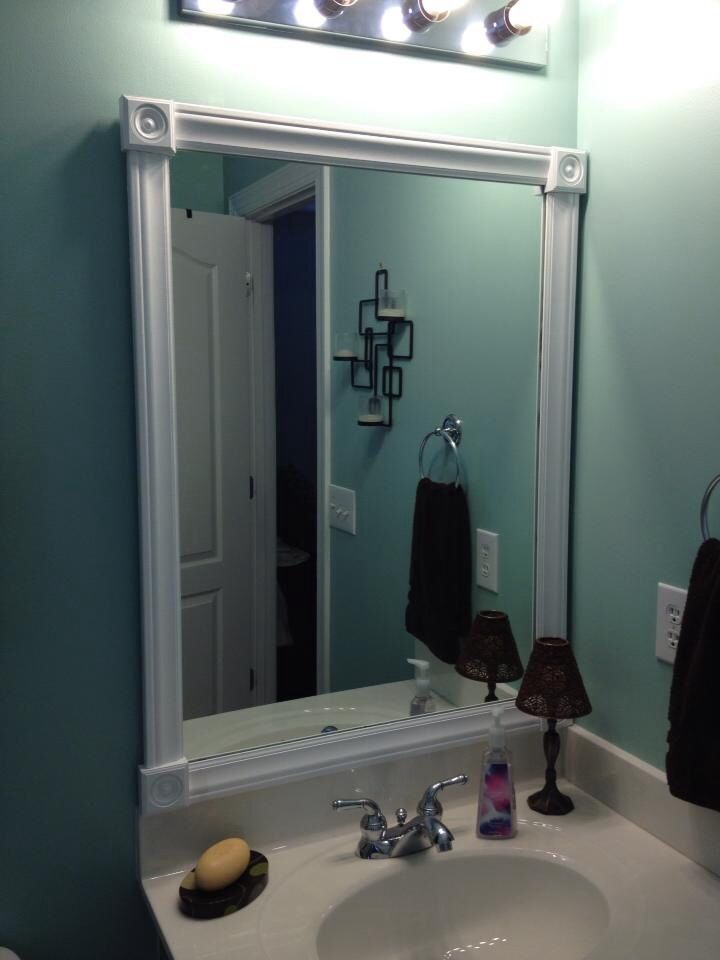 Framed Bathroom Mirror Cut Molding And Paint Used To Frame Ugly Bathroom Mirrors It 39 S Not