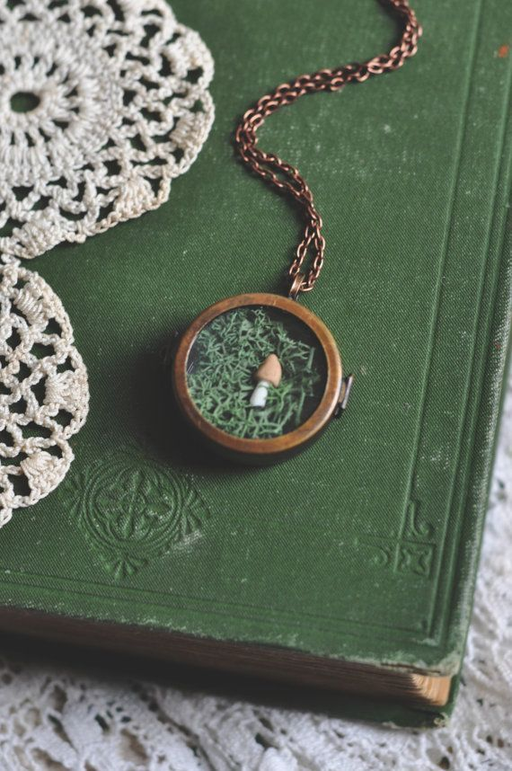 mushroom terrarium glass locket necklace.  In case I need another life?  Or is this an Alice situation?