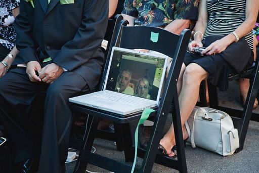 Love this idea! > Saving a seat a a wedding... connect via skype for guests that live abroad or are deployed. so cute!