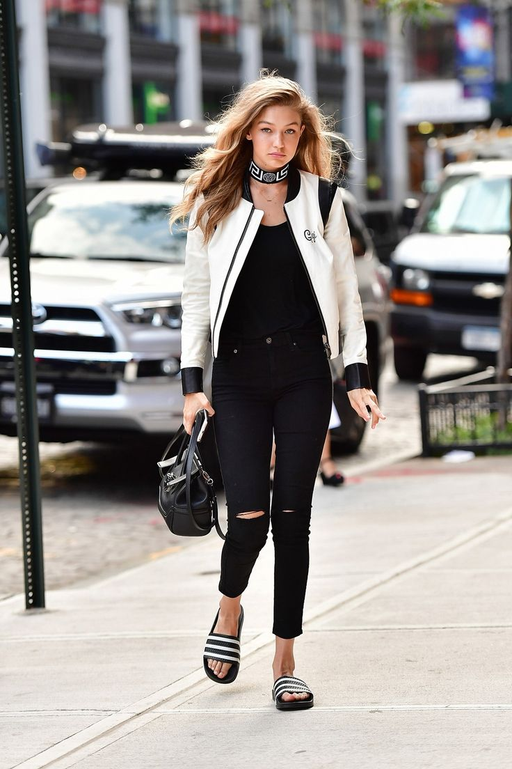Gigi Hadid in black skinny jeans, a bomber jacket and slides - click through to see this week's best-dressed list