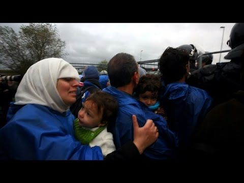Migrants cross Croatia-Slovenia border after cold, wet wait