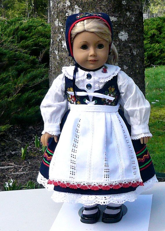 American Girl 18 inch doll clothes: by Calyxadollcreations on Etsy. Anna used Swedish curtain material from IKEA for the apron. She used white and red hand crocheted lace from a vintage table cloth she bought in Sweden on her last trip.