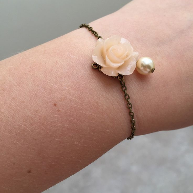 A personal favorite from my Etsy shop https://www.etsy.com/listing/234499877/pretty-bracelet-with-pale-peach-flower