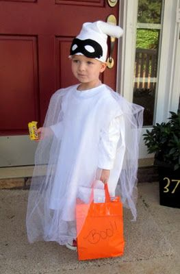 Layer white tulle over a long white shirt - smart! And a plain black mask to still get the ghost look without having a sheet over your kids' head. Craft, Interrupted: BOO! A Homemade Ghost Costume.: