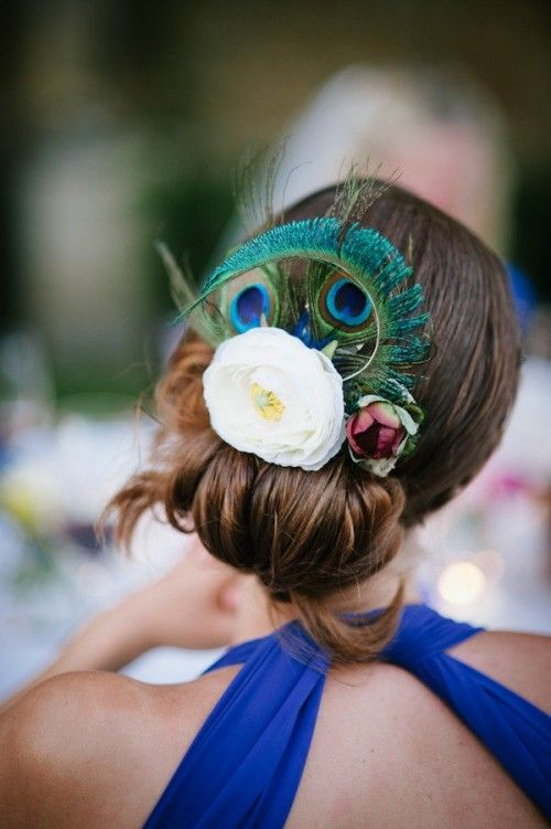 This bride's hair details includes a beautiful peacock feather.