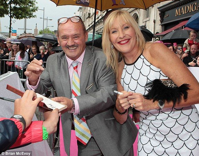 In good cheer: Brendan O'Carroll and Jennifer Gibney sign autographs for fans