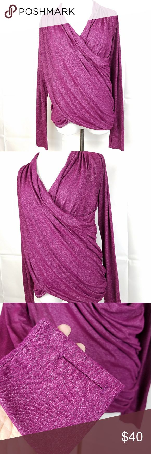 Athleta Long Sleeve Wrap Top Fuschia Womens Small This oh-so-soft top is the perfect mix between a wrap and a long sleeve athletic top. The material is stretchy and soft, and the fit is loose through the torso with a long back and thumbholes! The color is a heathered Fuschia and this top is in excellent condition, no flaws. Looks and feels like new. Athleta Tops Tees - Long Sleeve