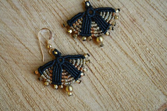 these african black and gold beaded macrame earrings are beautifully ethnic and tribal. they make a huge statement and will add a boho touch to any look- without the weight. hand woven by me using the ancient technique of macrame, i create these knot by knot with great love and care. i use the finest quality waxed cord, brass beads and a goldfilled ear stud. length: approx 2 inches width: approx 1.5 inches if you would like me to change the colors- thats totally possible- just convo. me ...