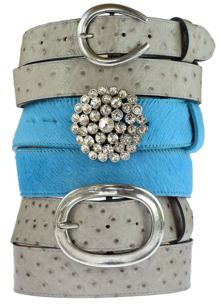 Grey ostrich belt in 30mm width and 40mm with detachable belt buckles. Turquoise cowhide belt with Detachable swarovski waterlilly buckle £150.