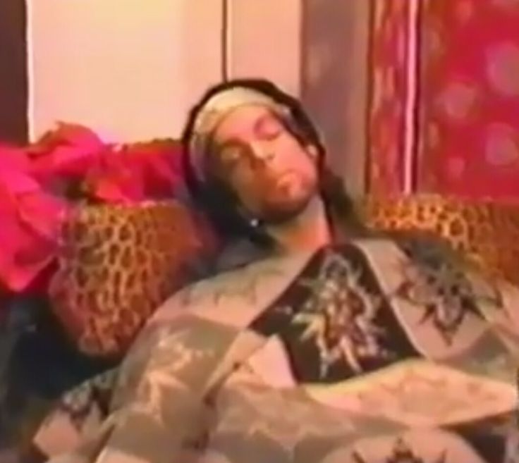 "Prince pretending to 'nap' before his appearance on MTV'S ""Total Request Live."" He didn't perform because he had a touch of laryngitis."