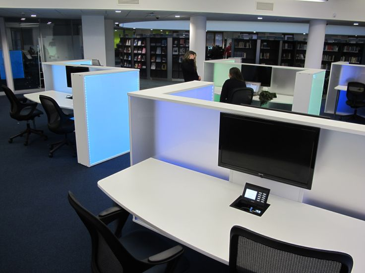 Collaborative learning desk with mounted PC screen.  Illuminated side panels can be set to different colours.  Designed and fitted by Opening the Book at Nottingham Trent University Boots Library.