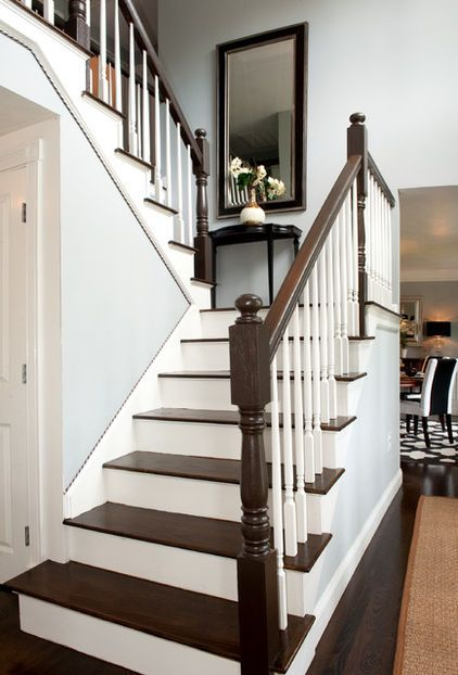 love the stairs!  Two-toned cording adds subtle detail between the front entry stair molding and the wall.    Wall paint: Winter Solstice, Benjamin Moore; stair railings: Appalachian Brown Semi-Gloss, Benjamin Moore