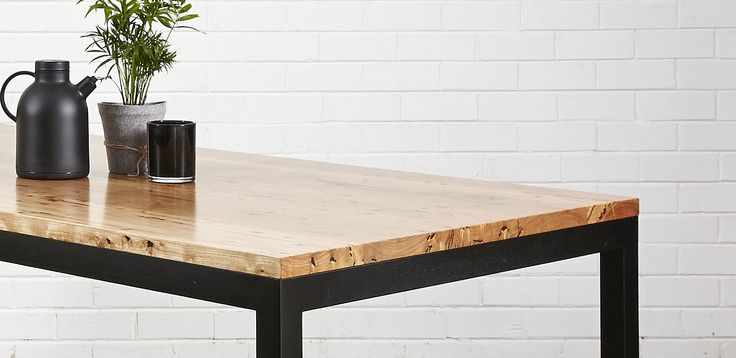 Having black legs on your dining table is a nice way to break up the 'timber on timber' look if you have floorboards.