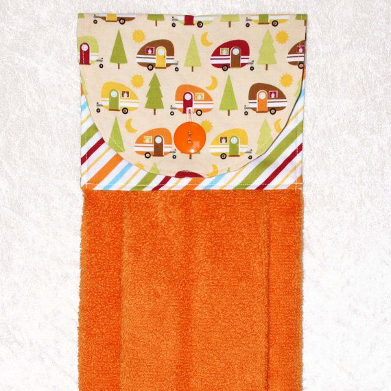 Always have a towel at the ready with this handmade hanging towel. Featuring a designer fabric of colorful teardrop trailers on peach and a coordinating striped fabric, it is sure to add fun to your kitchen.   Camping Kitchen Towel • Orange Tea Towel • Ca
