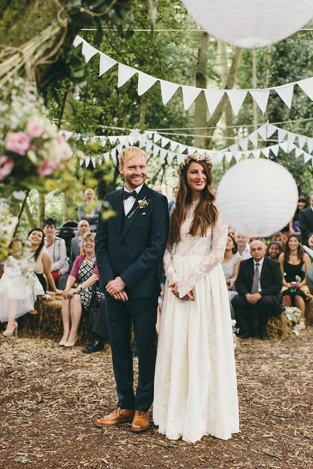All white bunting and paper lanterns as wedding ceremony decor