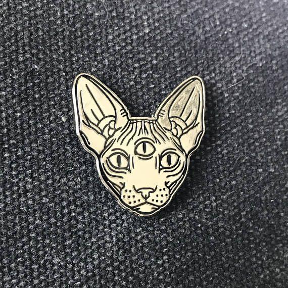 Zilver metaal / zwart sphynx kat pin