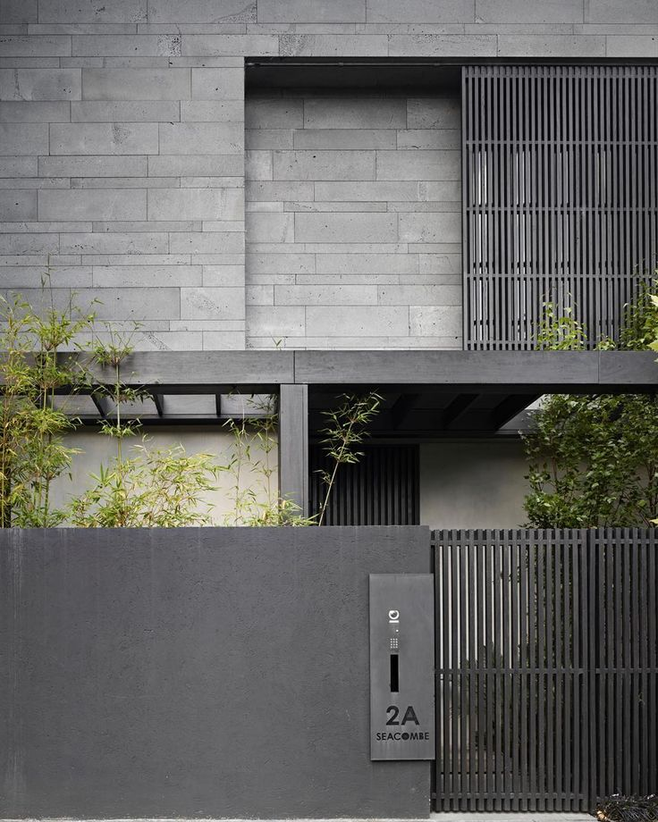 Bluestone facade with timber details at the Seacombe Grove Residence by B.E Architecture in Brighton