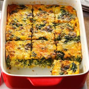 Eggs Florentine Casserole Recipe -For our Christmas brunch, I make eggs, sausage and spinach into a snappy casserole. Sometimes I mix in fresh peppers or green chilies, so play with it. —Karen Weekley, Washington, WV