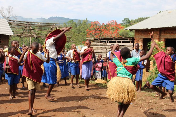 Children showcasing their dancing skills on a visit to the school