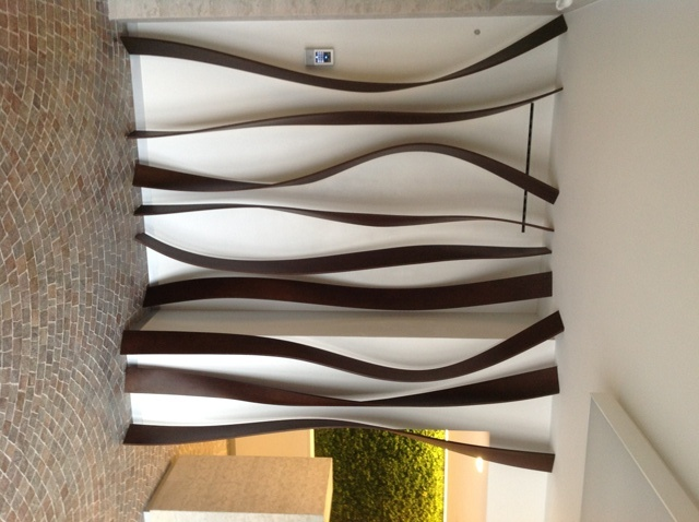 Associazioni Artigiani_Trento. Entrance: shaped staves and wall tile in real moss.