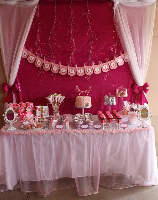 tulle table skirt and tulle between the letters on the banner
