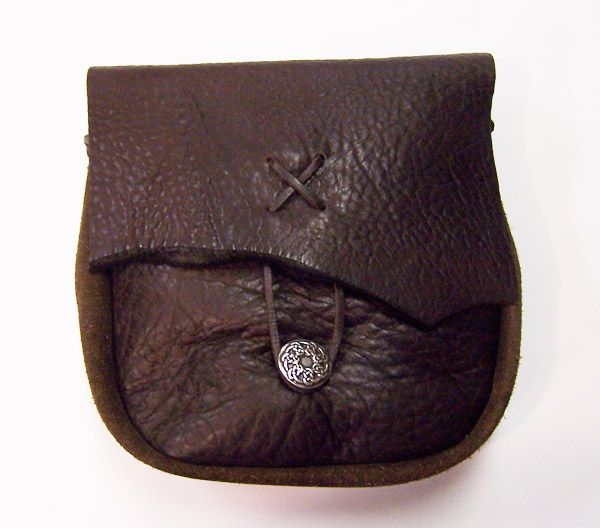 He's sewing a leather pouch
