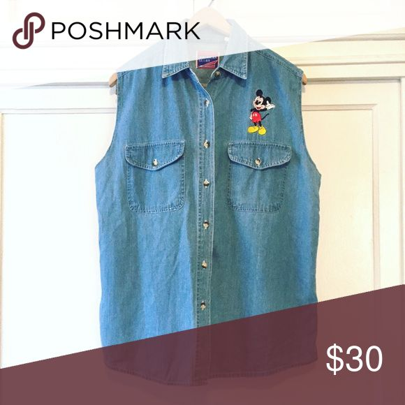 "Vintage Mickey Mouse sleeveless denim shirt Oversized denim sleeveless shirt with Mickey Mouse embroidered on it! Made in Kenya, which I've never seen before. Tagged L, 23"" pit to pit and 29"" long. Cute oversized fit. Vintage Tops"