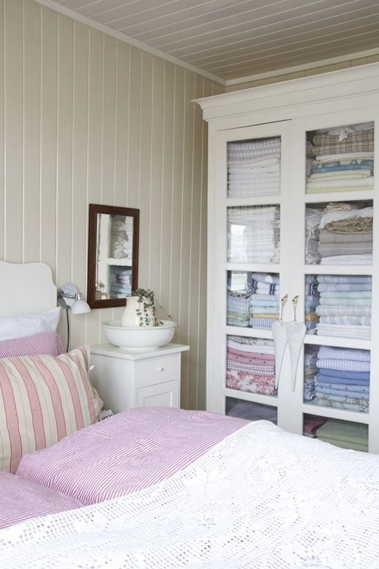 Medicine Cabinet Turned Linen Closet   Colorful Sheets   White And Bright