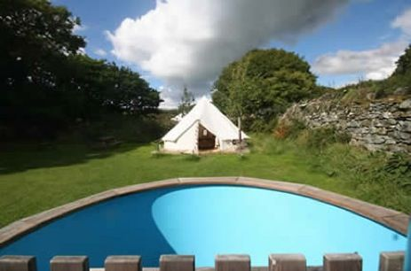 Glamping Wales with Hot Tub at Hideaways in the Hills. Luxury camping in a bell tent or pod in Snowdonia in North Wales. Accommodation includes proper bed.