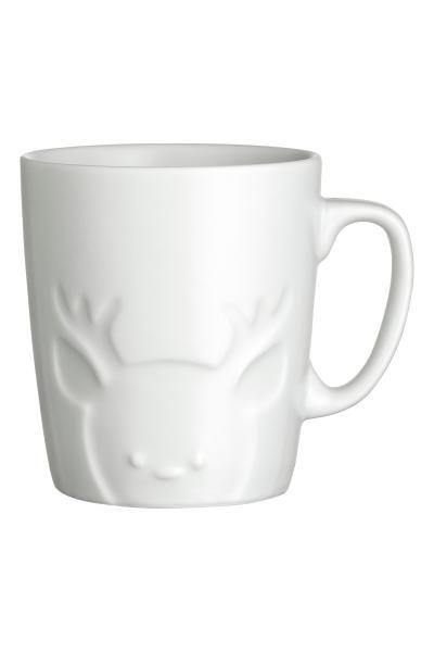 Mug en porcelaine: Mug en porcelaine avec motif en relief. Diamètre 7,5 cm, hauteur 8,5 cm.