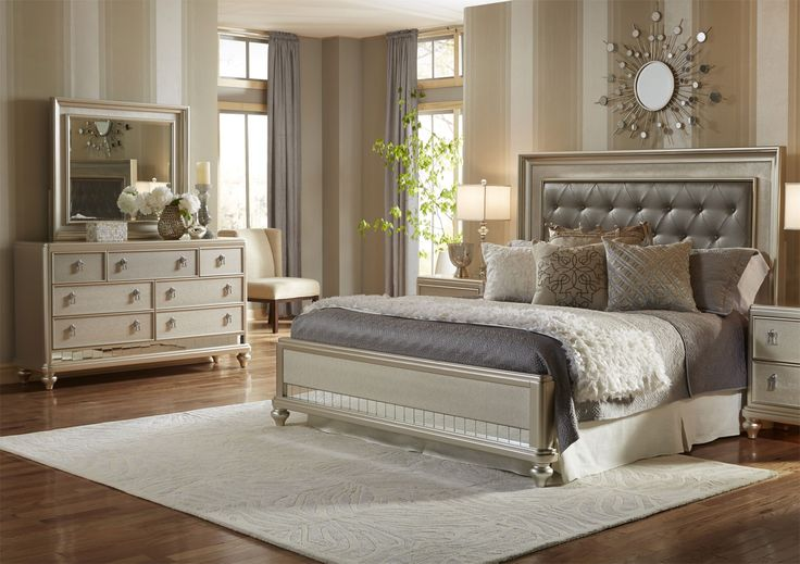 Create an alluring bedroom ambience with this Diva five-piece bedroom set. Finished in a striking silver tone and accented with faux crystal drawer knobs, this set is perfect for those who want a dramatic aura in their bedroom. Faux leather on the headboard is button-tufted for a plush look, enhancing the Diva's posh appearance. Resting on bun-shaped feet, this bedroom set will give your room a sophisticated glow.