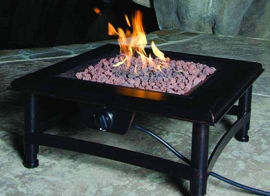 "Titan Propane Gas Fire Pit This stainless steel beauty burns liquid propane and utilizes an electronic ignition for an easy start. It measures 34"" square, the perfect size for a small porch to a large."