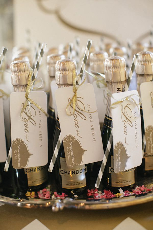 Cool mini champagne bottle wedding favors with small card