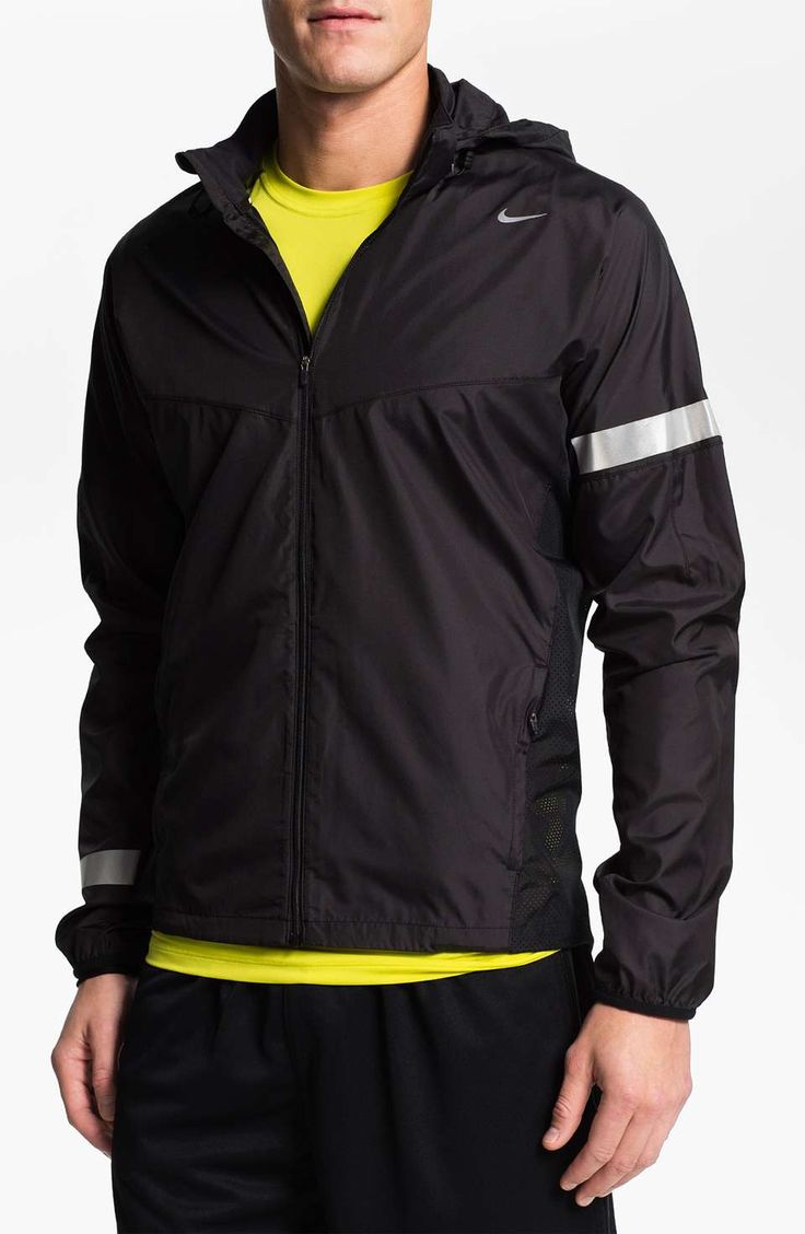 A water-repellent jacket cut with a smart fit offers super-lightweight protection from the wind and rain with a dropped hem and detachable hood. Perforated insets on the sides and back enhance cooling airflow.Approx. length from shoulder: 27.Measurements taken from size Medium and may vary slightly by size.Front zip closure.Reflective trim.Side pockets.Polyester; machine wash.By Nike; imported.Men's Sportswear.