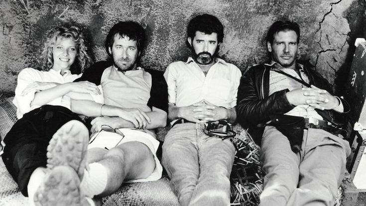 Kate Capshaw (Willie Scott), Director Steven Spielberg, Producer George Lucas, & Harrison Ford (Indiana Jones) on the Set of Indiana Jones and the Temple of Doom (1984)