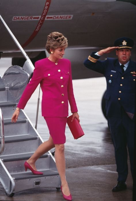 Date/info update: TRH Prince Charles and Princess Diana arrive in Sudbury during their Royal Tour of Canada October 1991.. Princess Diana being saluted. Bright, what they call shocking pink coloured suit with gold buttons.