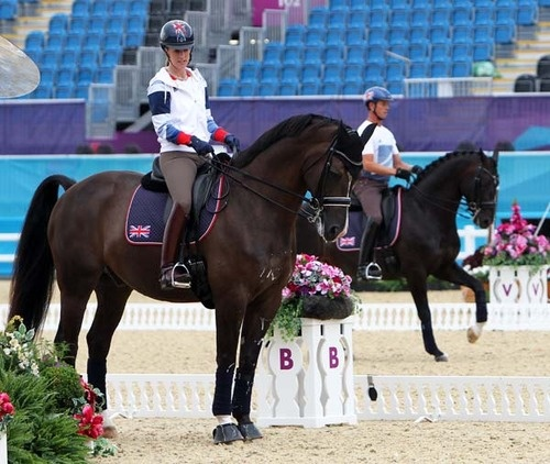 Charlotte Dujardin and Valegro, with Carl Hester and Uthopia in the background, of Great Britain