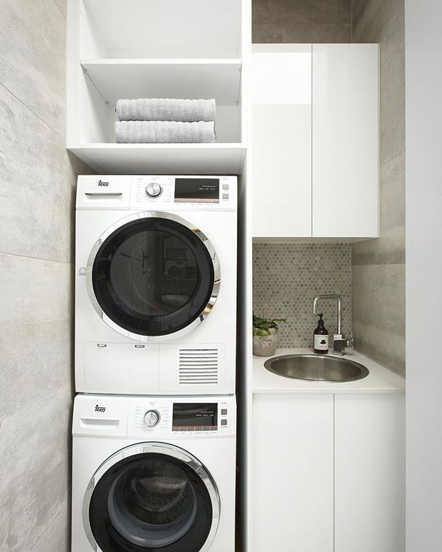 Cute and compact - this is all about making the most of a small laundry space. Beautifully finished with Teka appliances, @caesarstoneau benchtop and tiled splashback. #laundry #design #laundrytolove
