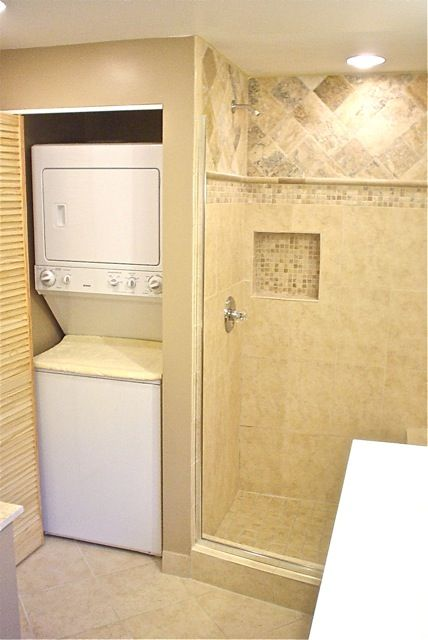Stackable washer and dryer in the bathroom - this would need a door and some nice molding around the edges.