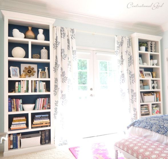 Make an IKEA Billy bookcase more stylish and refined  - add crown molding, trim, and dividers (BM 'Dove White' matches), paint back Glidden 'Regal Wave')
