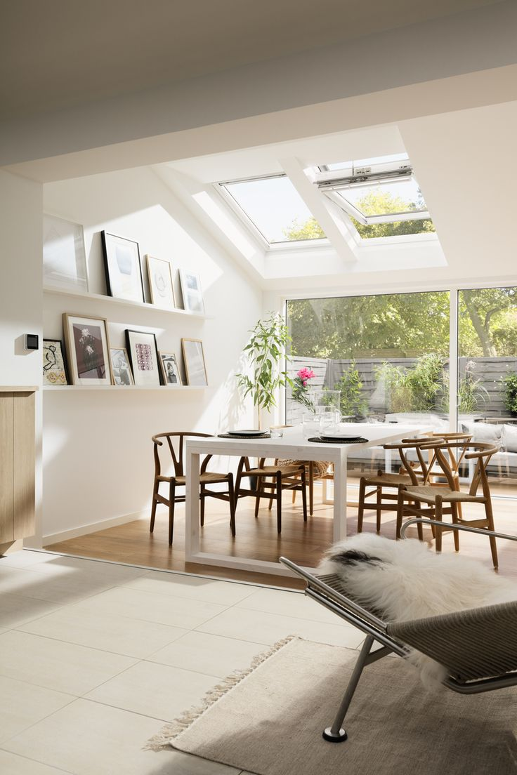 Love how the roof window casts a wonderful pocket of light down onto the dining table and beyond.
