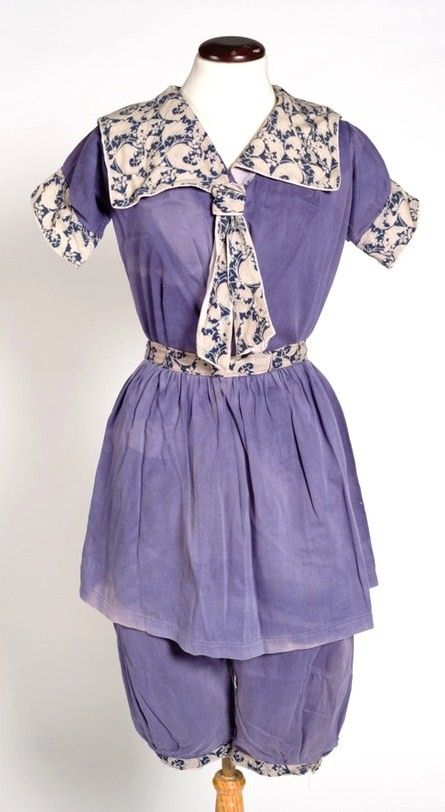 1890 Bathing Suit - lovely periwinkle  blue.  Pantaloons and skirted top with sailor collar & tie.  Top is further accented with cinched waist belt and cuffs on the short sleeves