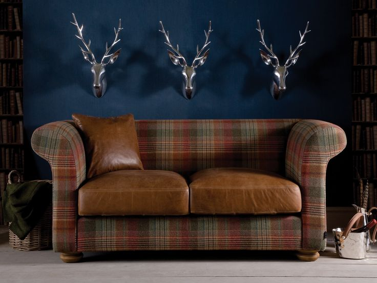 The Grandad Leather and Highland Wool Sofa is covered in fabric tartan and has Indigo's premium hide leather cushions #leatherandwool #tartansofa #tartan