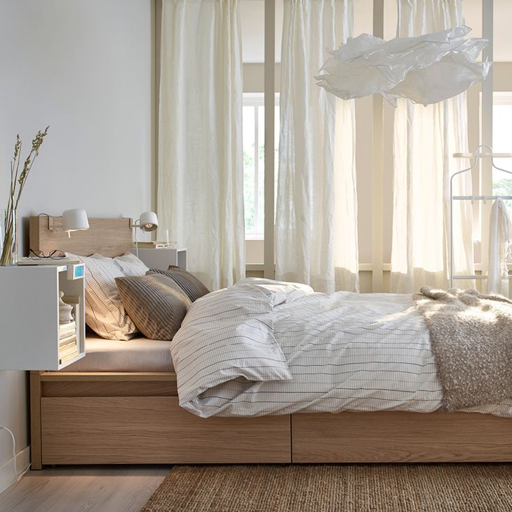 Live your bedroom storage dreams with a MALM bed with storage boxes.