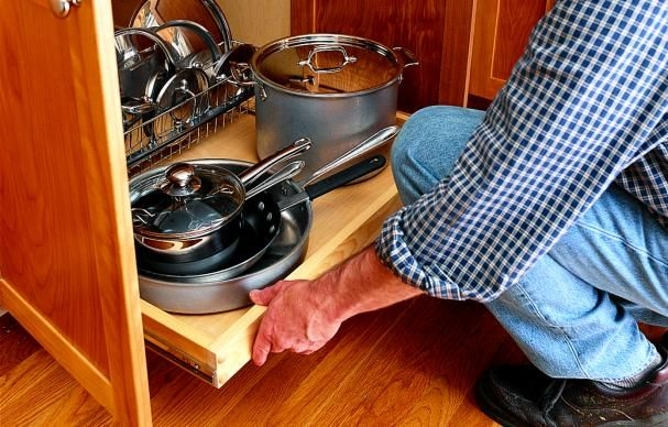 Norm Abram shows how to create easy access to items in a kitchen base cabinet